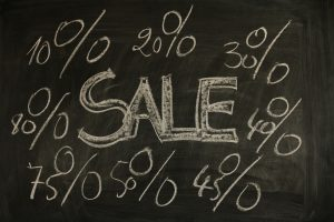 chalk board with sales percentages